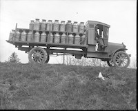 Milk delivery truck standing on roadway