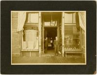 Two men stand in front of A. H. Dahl store