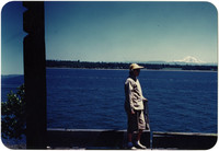 Woman standing on pier with Mt Baker visible in the distance