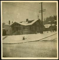 Street view of house on corner on a snowy day