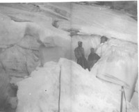 Climbers on ice face