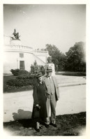 Man and woman pose on grounds of landmark or monument in Washington, D.C.