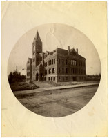 """Large stone Whatcom County Courthouse with central clock tower, located between """"G"""" and  """"H"""" streets on Ellsworth Street, Bellingham, WA"""