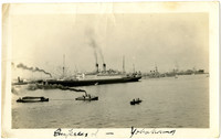"""Large passenger steamship """"Empress of Yokohama"""" in unidentified harbor with several smaller vessels"""