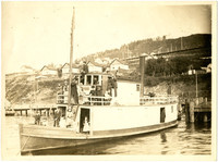 "Men and women on upper and lower decks of steam-powered passenger ferry ""Brick"" docked at Sehome"
