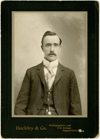 Man in suit poses for studio portrait