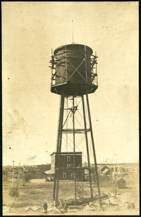 A water tower under construction with the tank surrounded by scaffolding
