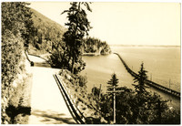 Southerly view of Chuckanut drive with railroad trestle spanning water on right