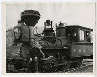 Two railroad workers with B.B. & B.C. steam engine