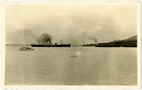 Unidentified large steam freight ship docked at Pacific American Fisheries facility, Bellingham Bay