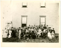 Large group of men and women of the Whatcom County Teachers' Institute stand in front of Lynden Normal School, 1890