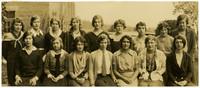 Fairhaven High School girls pose in two rows outside school