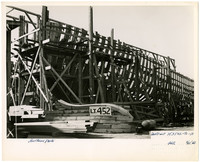 The wooden skeleton of a ship under construction at Northwestern Shipyward, Bellingham, Washington