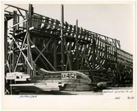 The wooden skeleton of a ship under construction at Northwestern Shipyward, Bellingham, Washington