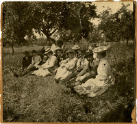 Approximately a dozen well-dressed women and men  sit in field