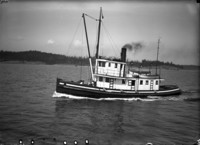 """Portside view of the steam tender """"Rodoma"""" somewhere on Puget Sound."""