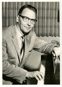 Man seated at piano