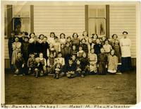 Sunshine School - school children pose with teacher outside schoolhouse