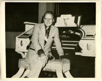 Gunnar Anderson seated at large electric organ