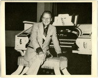 Gunnar Anderson seated at large electric organ