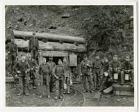 Thirteen miners pose at entrance of Blue Canyon Coal , Mine, south Lake Whatcom, WA