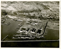 Bellingham Iron Works - aerial view of Bellingham harbor, marina with breakwater,  and city on bluff beyond