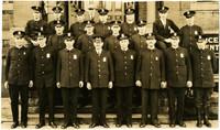 Bellingham Police Department posing on front steps of building