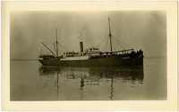 """Starboard side of teamship """"Windber"""" shows its reflection in calm waters"""