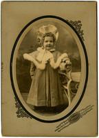 Studio Portrait of young girl in fancy coat and hat