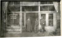 Three men stand outside Kulshan Cigar Store