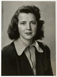 Studio portrait of Annette Miller, woman with dark, shoulder-length hair