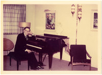 An unidentified man (probably Gunnar Anderson), seated at a piano