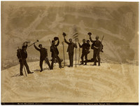 Six men standing on a snowy summit of Mt. Baker