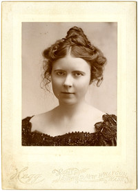 Formal studio portrait of Rita Christopher Newman, a young woman