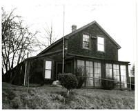 Exterior of Pickett House in Bellingham, WA, a shingled, two-story house built in 1856.