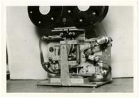Closeup of 35mm film perforating machine