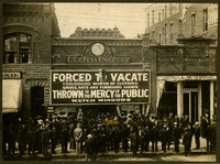 """Throng of men crowd around store front of The Globe Clothing Co. with """"Forced to Vacate"""" advertisement"""