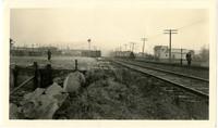 Two rail tracks extend towards horizon