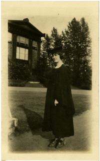 Young woman in graduation cap and gown at University of Washington