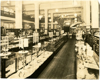 Interior of Wahl's Department Store shows display counters and clerks
