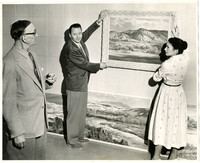 Paul Lauritz at hanging of his painting in Bellingham Public Library