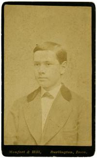 Formal studio portrait of unidentified teenage boy