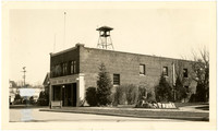 Exterior front and side view of Mount Vernon, Washington, brick fire hall building with doors open