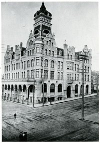 Exterior corner view of the grand Fairhaven Hotel with wood-plank streets in foreground