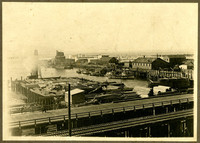 Citizen's Dock under construction, Bellingham Bay, WA, with Roeder Avenue and elevated railroad tracks in foreground