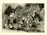 Vacation Bible Class- First Baptist Church. Large group of school children pose on steps of church