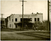 Exterior of Pacific American Fisheries building being demolished after a fire