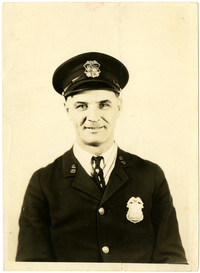 Seated portrait of police officer Eaerl Dunkle