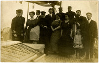 Crew and family on deck of navy ship