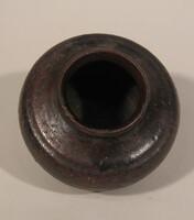 Jar raised on three low feet